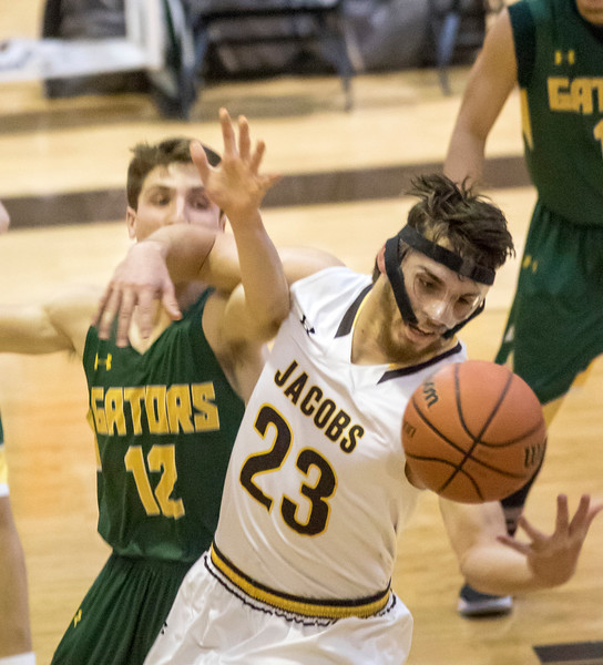 Sarah Nader - snader@shawmedia.com Crystal Lake South's Ryan Lawson (left) and Jacobs' Daniel Murray reach for the rebound during the second quarter  at Jacobs' Hinkle Holiday Classic Wednesday, Dec. 27, 2017. Jacobs won, 54-40.