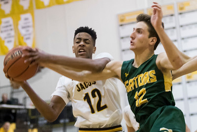 Sarah Nader - snader@shawmedia.com Jacobs' Kameron Mack (left) and Crystal Lake South's Ryan Lawson reach for a rebound during the third quarter at Jacobs' Hinkle Holiday Classic Wednesday, Dec. 27, 2017. Jacobs won, 54-40.