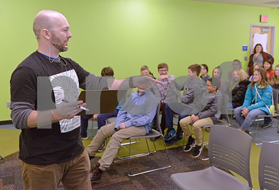 Chris Fair  and a live cartoon using laser reactive technology at the Glen Ellyn Public Library