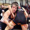 St. Charles East's Ben Anderson wrestles in the 120-pound semifinal match during the Upstate Eight Conference meet at St. Charles East on Jan. 20. Anderson won the match by fall.