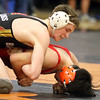 Batavia's Justin Major, top, wrestles with Glenbard East's Emiliano Garcia in the 138-pound semifinal match during the Upstate Eight Conference meet at St. Charles East on Jan. 20.