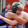 Geneva's Tony Vilches wrestles in the 132-pound weight class during Saturday's Upstate 8 Conference meet at St. Charles East.
