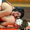 St. Charles East's Petyon Schroeder, top, wrestles with Glenbard East's Nick Guthrie in the 132-pound semifinal match during the Upstate Eight Conference meet at St. Charles East on Jan. 20.