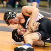 St. Charles East's Justin Benjamin, top, wrestles with Batavia's Alex Cruz in the 126-pound semifinal match during the Upstate Eight Conference meet at St. Charles East on Jan. 20.
