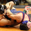 St. Charles East's Niko Derain, left, wrestles with South Elgin's Elijah Lopez in the 145-pound semifinal match during the Upstate Eight Conference meet at St. Charles East on Jan. 20.