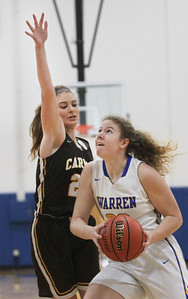 Candace H. Johnson-For Shaw Media Carmel's Grace Jones tries to block a shot by Warren's Dana Lundtveit in the first quarter during the Blue Devil Classic girls varsity basketball holiday tournament at Warren Township High School in Gurnee. Warren won 43-30. (12/29/18)