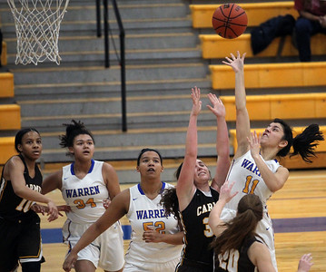Candace H. Johnson-For Shaw Media Warren's Jesette Ezernack (#11) jumps up for a shot over Carmel's Taryn Dwyer and Grace Jones in the second quarter during the Blue Devil Classic girls varsity basketball holiday tournament at Warren Township High School in Gurnee. Warren won 43-30. (12/29/18)