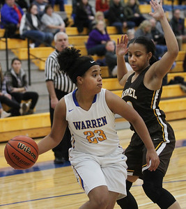 Candace H. Johnson-For Shaw Media Warren's Trenise Powe looks to pass against Carmel's Shai Horton in the first quarter during the Blue Devil Classic girls varsity basketball holiday tournament at Warren Township High School in Gurnee. Warren won 43-30.