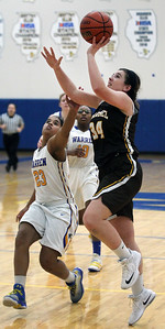 Candace H. Johnson-For Shaw Media Warren's Trenise Powe tries to block a shot by Carmel's Taryn Dwyer in the fourth quarter during the Blue Devil Classic girls varsity basketball holiday tournament at Warren Township High School in Gurnee. Warren won 43-30.