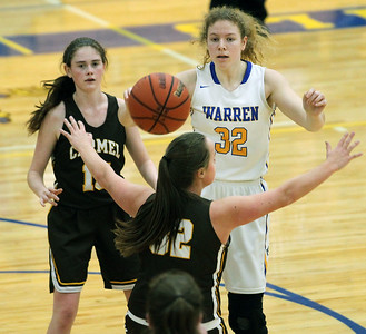Candace H. Johnson-For Shaw Media Warren's Dana Lundtveit (#32) passes the ball over Carmel's Lily Coulthard in the second quarter during the Blue Devil Classic girls varsity basketball holiday tournament at Warren Township High School in Gurnee. Warren won 43-30. (12/29/18)