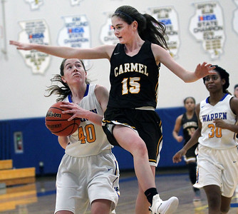 Candace H. Johnson-For Shaw Media Warren's Macy Kocen looks up for a shot against Carmel's Caitlin Teehan in the first quarter during the Blue Devil Classic girls varsity basketball holiday tournament at Warren Township High School in Gurnee. Warren won 43-30. (12/29/18)