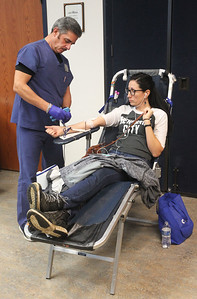 Candace H. Johnson-For Shaw Media Sam Alcazar, of Libertyville, donor tech 2, takes blood from Maria Guzman, of Round Lake Beach during the Vitalant Blood Drive at the Grayslake Area Public Library. (12/27/18)