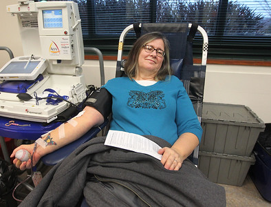 Candace H. Johnson-For Shaw Media Ann Drevalas, of Grayslake gives blood during the Vitalant Blood Drive at the Grayslake Area Public Library. (12/27/18)
