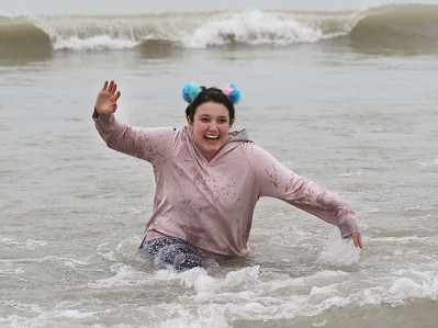 Candace H. Johnson-For Shaw Media Brannon Albert, of Augusta, Ga. runs out of the water during the 20th Annual Waukegan Polar Bear Plunge at Waukegan Municipal Beach. Albert took the plunge with her boyfriend, Mason Carter. The event was hosted by the Waukegan Park District and the City of Waukegan. Proceeds from the event will go to the Special Recreation Services of Northern Lake County. (1/1/19)