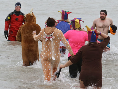 Candace H. Johnson-For Shaw Media Plungers from Team Jesters make their way through Lake Michigan during the 20th Annual Waukegan Polar Bear Plunge at Waukegan Municipal Beach. The event was hosted by the Waukegan Park District and the City of Waukegan. Proceeds from the event will go to the Special Recreation Services of Northern Lake County. (1/1/19)