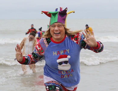 Candace H. Johnson-For Shaw Media Shawn Bruehl, of Wadsworth with Team Jesters is all smiles as she runs out of Lake Michigan during the 20th Annual Waukegan Polar Bear Plunge at Waukegan Municipal Beach. The event was hosted by the Waukegan Park District and the City of Waukegan. Proceeds from the event will go to the Special Recreation Services of Northern Lake County. (1/1/19)