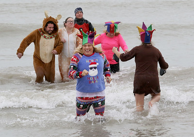 Candace H. Johnson-For Shaw Media Shawn Bruehl, of Wadsworth with Team Jesters runs out of Lake Michigan during the 20th Annual Waukegan Polar Bear Plunge at Waukegan Municipal Beach. The event was hosted by the Waukegan Park District and the City of Waukegan. Proceeds from the event will go to the Special Recreation Services of Northern Lake County. (1/1/19)