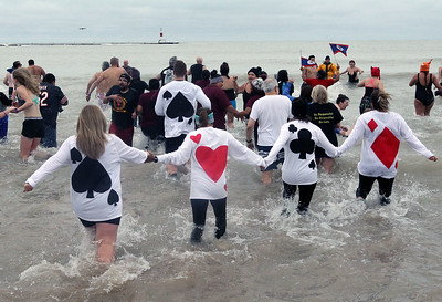 "Candace H. Johnson-For Shaw Media ""Dealing with a Full Deck"" plungers run into Lake Michigan during the 20th Annual Waukegan Polar Bear Plunge at Waukegan Municipal Beach. The event was hosted by the Waukegan Park District and the City of Waukegan. Proceeds from the event will go to the Special Recreation Services of Northern Lake County. (1/1/19)"