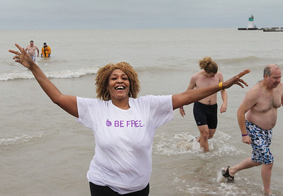 Candace H. Johnson-For Shaw Media Patricia McGhee, of Waukegan is all smiles as she runs out of Lake Michigan during the 20th Annual Waukegan Polar Bear Plunge at Waukegan Municipal Beach. The event was hosted by the Waukegan Park District and the City of Waukegan. Proceeds from the event will go to the Special Recreation Services of Northern Lake County. (1/1/19)