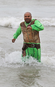 "Candace H. Johnson-For Shaw Media Shawn White, ""Cactus Jack,"" of Zion runs through Lake Michigan during the 20th Annual Waukegan Polar Bear Plunge at Waukegan Municipal Beach. The event was hosted by the Waukegan Park District and the City of Waukegan. Proceeds from the event will go to the Special Recreation Services of Northern Lake County. (1/1/19)"
