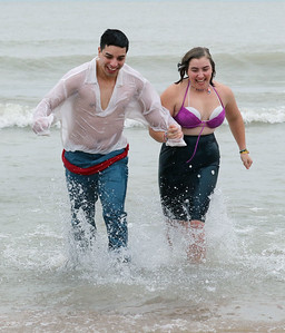 Candace H. Johnson-For Shaw Media Eric Bonilla, of Waukegan and his girlfriend, Lynsey Gallagher, of Kenosha, Wis., run in Lake Michigan together during the 20th Annual Waukegan Polar Bear Plunge at Waukegan Municipal Beach. The event was hosted by the Waukegan Park District and the City of Waukegan. Proceeds from the event will go to the Special Recreation Services of Northern Lake County. (1/1/19)