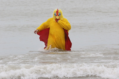 Candace H. Johnson-For Shaw Media Tony Rocha, of Waukegan runs through Lake Michigan dressed as a chicken during the 20th Annual Waukegan Polar Bear Plunge at Waukegan Municipal Beach. The event was hosted by the Waukegan Park District and the City of Waukegan. Proceeds from the event will go to the Special Recreation Services of Northern Lake County. (1/1/19)