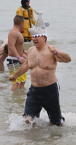 Candace H. Johnson-For Shaw Media Lance Nalezny, of Mundelein runs out of the water during the 20th Annual Waukegan Polar Bear Plunge at Waukegan Municipal Beach. The event was hosted by the Waukegan Park District and the City of Waukegan. Proceeds from the event will go to the Special Recreation Services of Northern Lake County. (1/1/19)