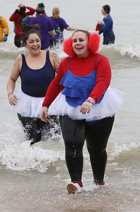 Candace H. Johnson-For Shaw Media Charlet Dornbusch, of South Elgin and Jazmine Mercado, of Waukegan head for dry land during the 20th Annual Waukegan Polar Bear Plunge at Waukegan Municipal Beach. The event was hosted by the Waukegan Park District and the City of Waukegan. Proceeds from the event will go to the Special Recreation Services of Northern Lake County. (1/1/19)