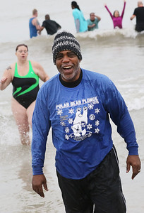 Candace H. Johnson-For Shaw Media Lake County Sheriff John Idleburg is all smiles as he runs out of Lake Michigan during the 20th Annual Waukegan Polar Bear Plunge at Waukegan Municipal Beach. The event was hosted by the Waukegan Park District and the City of Waukegan. Proceeds from the event will go to the Special Recreation Services of Northern Lake County. (1/1/19)