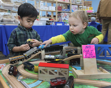 Candace H. Johnson-For Shaw Media Josiah Selvacion, of Buffalo Grove and Grayson Unell, of Antioch, both 2, play with wooden trains in the Choo Choo Track & Toy Co. booth during the Great Train Show at the Lake County Fairgrounds in Grayslake. (12/29/18)