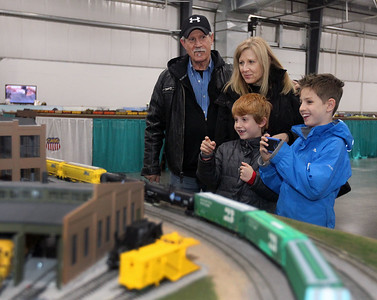 Candace H. Johnson-For Shaw Media Brian and Lou Ann Gerald, of Grayslake and their grandchildren, Matty Furrow, 9, of Wilmslow, England and his brother, Jacob, 9, enjoy watching model trains run on a track from the Lake County Society of Modular Engineers during the Great Train Show at the Lake County Fairgrounds in Grayslake. (12/29/18)