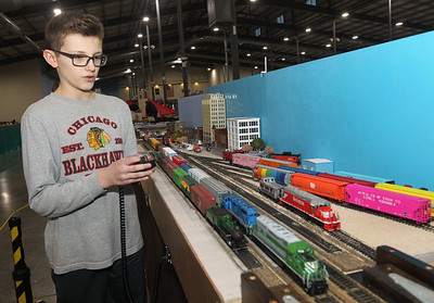 Candace H. Johnson-For Shaw Media Sam Foster, 11, of Gurnee uses a train controller to control a 1st Union Rail SD40-2 model train carrying mixed freight as it passes by him during the Great Train Show at the Lake County Fairgrounds in Grayslake. Sam's model train ran on the tracks on display by the Lake County Society of Modular Engineers. (12/29/18)