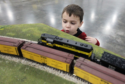 Candace H. Johnson-For Shaw Media Jaxon Sievert, 5, of Hawthorn Woods watches a Nickel Rate Road S scale model train go by during the Great Train Show at the Lake County Fairgrounds in Grayslake. (12/29/18)