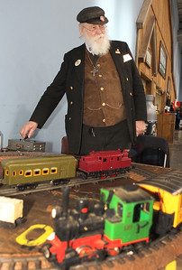 "Candace H. Johnson-For Shaw Media Joseph G. Steele, of Crystal Lake, ""Mr. Conductor,"" uses a transmitter to operate one of his 1940's Hafner wind-up trains during the Great Train Show at the Lake County Fairgrounds in Grayslake. (12/29/18)"