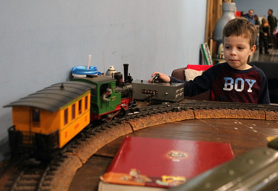 Candace H. Johnson-For Shaw Media Ethan McGovern, 5, of Round Lake pushes on a transmitter to operate a 1940's Hafner wind-up train during the Great Train Show at the Lake County Fairgrounds in Grayslake. The train was owned by Joseph G. Steele, of Crystal Lake. (12/29/18)