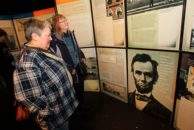 Candace H. Johnson-For Shaw Media Marcia Rose, of Gurnee and Marilyn Diehl, of Lindenhurst look at the free pop-up exhibit of President Abraham Lincoln on display at the Jack Benny Center for the Arts Theatre in Waukegan. The exhibit will be on display until January 19th. (1/6/19)