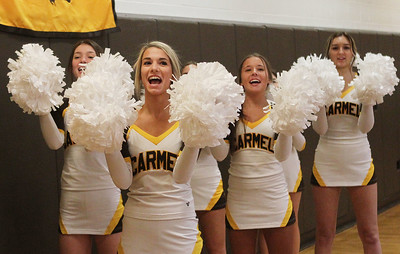 Candace H. Johnson-For Shaw Media Carmel's Taylor Cianci, 18, of Wauconda (second from left) and her team cheer for the boys varsity basketball players as they play against Lakes in the fourth quarter at Carmel Catholic High School in Mundelein. Carmel won 63-42. (1/8/19)