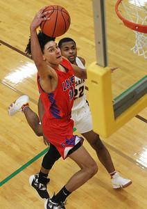 Candace H. Johnson-For Shaw Media Lakes Leighsean Triplett leaps up for a shot against Carmel's Kylen Beals in the second quarter at Carmel Catholic High School in Mundelein. Carmel won 63-42. (1/8/19)