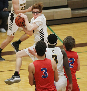 Candace H. Johnson-For Shaw Media Carmel's William Schott brings down a rebound against Lakes Bradley Cherry (#3) and Chance Andell (#22) in the third quarter at Carmel Catholic High School in Mundelein. Carmel won 63-42. (1/8/19)