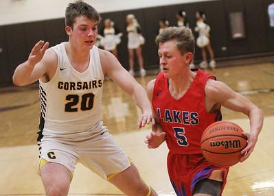Candace H. Johnson-For Shaw Media Lakes Matt Ott (#5) drives to the basket against Carmel's Lukas Galdoni (#20) in the fourth quarter at Carmel Catholic High School in Mundelein. Carmel won 63-42. (1/8/19)
