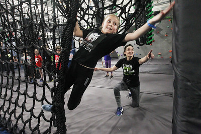 Candace H. Johnson-For Shaw Media Grace Hener, 10, of Gurnee gets some encouragement from Pro Ninja Tori Clement, of Naperville as she gets through a climbing obstacle course during Pro-Camp V at Ultimate Ninjas in Libertyville. (1/5/19)