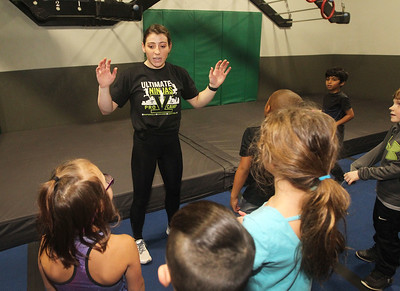 Candace H. Johnson-For Shaw Media Pro Ninja Barclay Stockett talks to a group of kids about conquering the Devil Steps obstacle course during Pro-Camp V at Ultimate Ninjas in Libertyville. (1/5/19)