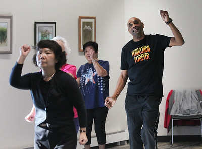 Candace H. Johnson-For Shaw Media Louis Kingsboro, of Wauconda (on right) keeps moving during Zumba for Families at the Wauconda Area Library. The program runs January through February every Saturday from 9:30-10:30 am. (1/5/19)