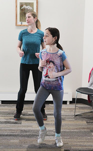 Candace H. Johnson-For Shaw Media Oksana Savvyeva, of Island Lake and her daughter, Olexandra, 11, work out together during Zumba for Families at the Wauconda Area Library. The program runs January through February every Saturday from 9:30-10:30 am. (1/5/19)