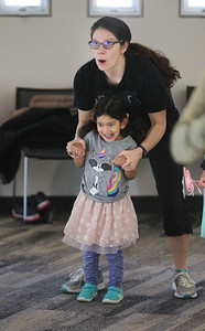 Candace H. Johnson-For Shaw Media Michelle Kora, of Buffalo Grove exercises with her daughter, Kaitlyn, 3, during Zumba for Families at the Wauconda Area Library. The program runs January through February every Saturday from 9:30-10:30 am. (1/5/19)