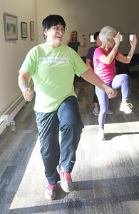 Candace H. Johnson-For Shaw Media Kathy Igliori, of Wheeling keeps moving as she exercises during Zumba for Families at the Wauconda Area Library. The program runs January through February every Saturday from 9:30-10:30 am. (1/5/19)
