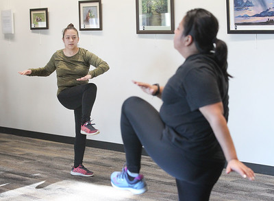 Candace H. Johnson-For Shaw Media Maria Arreguin, of Island Lake follows Yamel Azcoitia, of Round Lake Beach, the exercise instructor, during Zumba for Families at the Wauconda Area Library. The program runs January through February every Saturday from 9:30-10:30 am. (1/5/19)