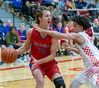 Dundee Crown's Joshua Raby drives along the baseline against Huntley's Ryan Crosby Tuesday, January 15, 2019 in Huntley. Dundee-Crown gets the win 53-50. KKoontz- For Shaw Media