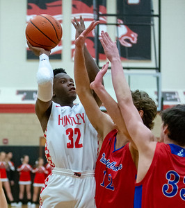 Huntley's Uchenna Egekeze goes up for the shot against Dundee-Crown's Joshua Raby Tuesday, January 15, 2019 in Huntley. Huntley tried to comeback in the fourth quarter, but ended up losing to the Chargers 53-50. KKoontz – For Shaw Media