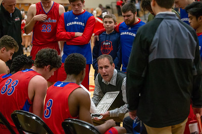 Dundee-Crown's head basketball coach Lance Huber draws up a play Tuesday, January 15, 2019 in Huntley. Dundee-Crown holds off Huntley 53-50. KKoontz- For Shaw Media